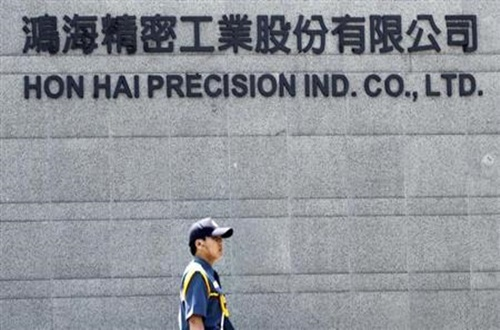 A security guard patrols at Hong Hai headquarters in Tucheng